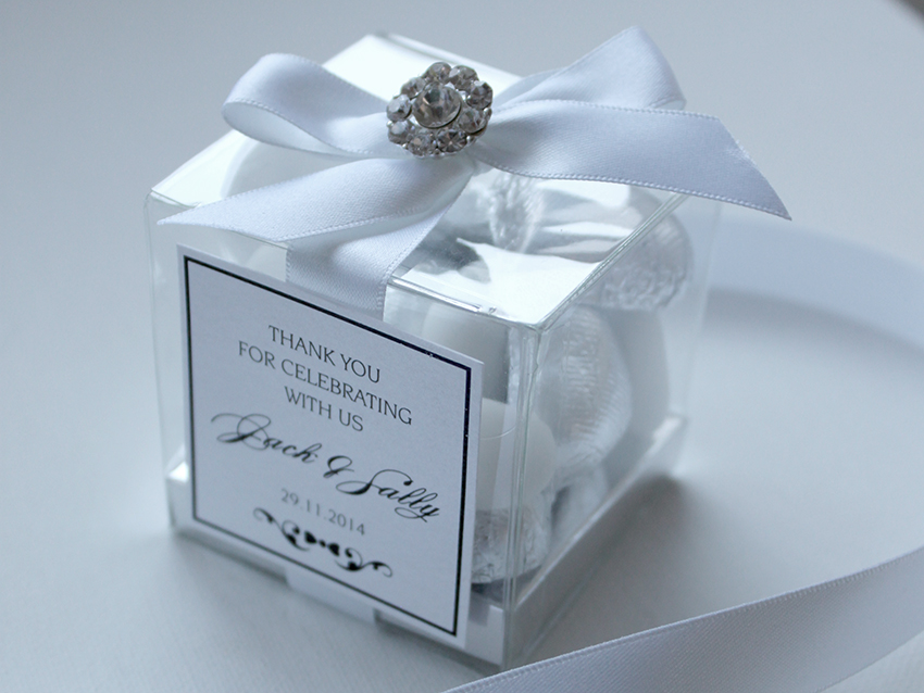 Clear cube filled with foil chocolate hearts and sugared almonds